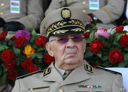 "Algerian chief of staff Gen. Ahmed Gaid Salah presides a military parade at the Cherchell ""Houari Boumediene"" in Algiers, July 1, 2018."