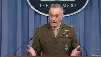 FILE - U.S. Joint Chiefs of Staff Chairman General Joseph Dunford is seen in a frame grab from U.S. Department of Defense video as he speaks to the media about the deaths of four U.S. Army special operations forces soldiers in Niger during a news con...