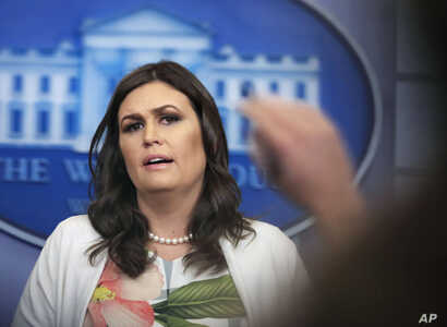 White House press secretary Sarah Huckabee Sanders talks to reporters during a press briefing in the Brady Press Briefing Room at the White House, in Washington, Nov. 27, 2017.