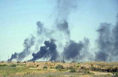 Smoke rises after airstrikes by U.S.-led coalition warplanes as Iraqi security forces advance their positions in the southern neighborhoods of Fallujah to retake the city from Islamic State militants, Iraq, June 12, 2016.