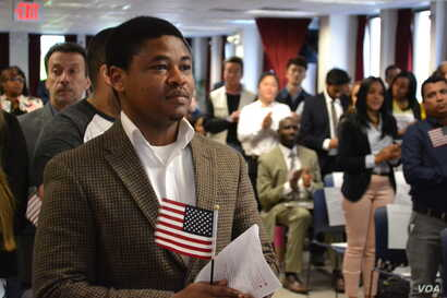 """Chijioke Anyira, from Nigeria, awaits the administration of oath.  """"I hold it in very high esteem to be an American,"""" said Anyira, after the ceremony. (R. Taylor/VOA)"""
