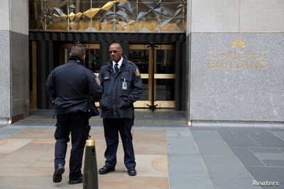 Police and security stand outside 30 Rockefeller Plaza, the location for the offices of U.S. President Donald Tump's lawyer Michael Cohen which was raided by the FBI today in the Manhattan borough of New York City, New York, April 9, 2018.