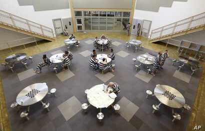 Inmates gather in the common room at the 192-bed facility at the Stanislaus County Jail in Modesto, California.