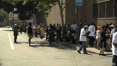 People line up on Skid Row in Los Angeles to receive food, water, clothing and other basic necessities from Humanitarian Day Muslim volunteers.