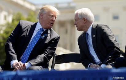 FILE PHOTO - U.S. President Donald Trump speaks with Attorney General Jeff Sessions as they attend the National Peace Officers Memorial Service on the West Lawn of the U.S. Capitol in Washington, May 15, 2017.