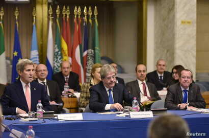 U.S. Secretary of State John Kerry (L), Italy's Foreign Minister Paolo Gentiloni (front C) and United Nation's envoy Martin Kobler (front R) take part in an international conference at the Ministry of Foreign Affairs in Rome, Dec. 13, 2015.