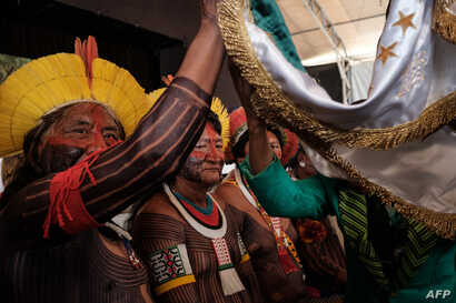 Indigenous leaders participate in the press conference given by the Imperatriz Leopoldinense samba school, whose theme this year pays homage to the native people of Brazil's Amazon region, ahead of the carnival parade at Cidade do Samba in Rio de Jan...