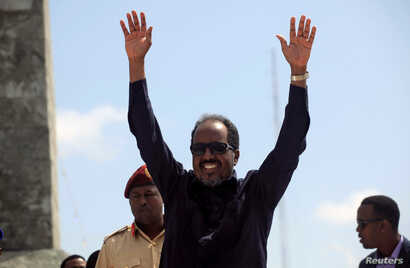 Somalia's President Hassan Sheikh Mohamud waves to the guests as he arrives for Independence Day celebrations outside the ruins of the former parliament buildings in Somalia's capital, Mogadishu, July 1, 2016.