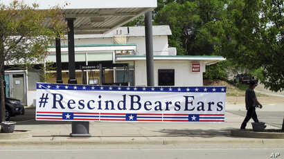 A sign hangs in Blanding, Utah as U.S. Interior Secretary Ryan Zinke arrived in the town, where he took a helicopter tour to see Bears Ears National Monument, May 8, 2017.