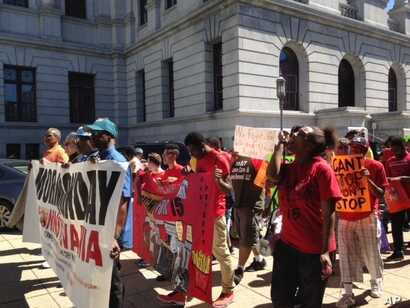 File -- In Harrisburg, Pennsylvania, about 200 people attend the Higher Ground Moral Day of Action march on September 12, 2016. A prominent part of their message was support for raising the minimum wage to $15 an hour.
