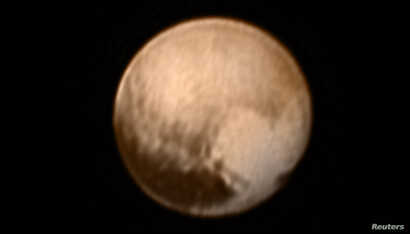 Pluto is pictured in this July 7, 2015, handout image from New Horizons' Long Range Reconnaissance Imager (LORRI).