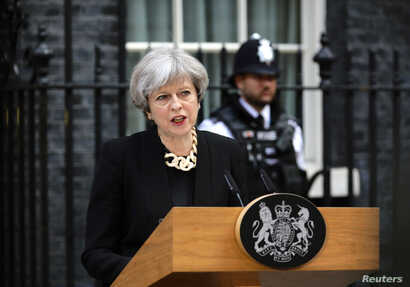 Britain's Prime Minister Theresa May speaks outside 10 Downing Street after an attack on London Bridge and Borough Market left 7 people dead and dozens injured in London, June 4, 2017.