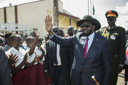 South Sudan President Salva Kiir waves as he greets schoolchildren at Juba International Airport in Juba on Sept. 13, 2018, after returning from the Ethiopian capital Addis Ababa where the latest peace agreement with opposition leader Riek Machar was...