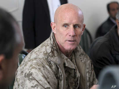 Vice Adm. Robert S. Harward, commanding officer of Combined Joint Interagency Task Force 435, speaks to an Afghan official during his visit to Zaranj, Afghanistan, Jan 6, 2011.