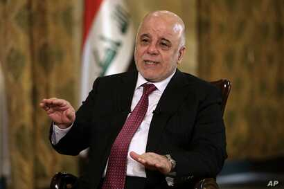 Iraq's Prime Minister Haider al-Abadi speaks during an interview with The Associated Press in Baghdad, Iraq, Sept. 16, 2017.
