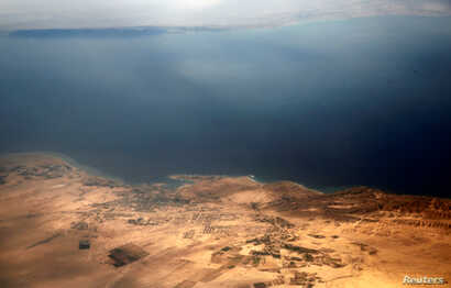 An aerial view of the coast of the Red Sea and the two islands of Tiran and Sanafir is pictured through the window of an airplane near Sharm el-Sheikh, Egypt Nov. 1, 2016.
