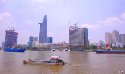 A view over the Saigon river next to Ho Chi Minh city's financial district … An expert in illegal wildlife trafficking says many of the people involved in the illicit trade in rhino horn are from this and other Vietnamese cities.