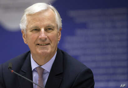 EU chief negotiator Michel Barnier smiles during a meeting  in Brussels, March 22, 2017.