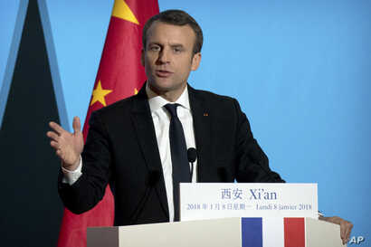 French President Emmanuel Macron delivers a speech at the Daming Palace in Xi'an in northwestern China's Shaanxi province, Monday, Jan. 8, 2018.
