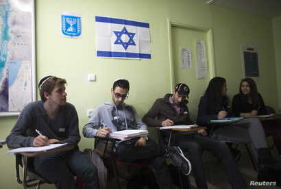 FILE - Newly arrived immigrants from France, all of whom are from Paris, study Hebrew at Ulpan Etzion, the original residential school and absorption center, in Jerusalem, Jan. 20, 2015.