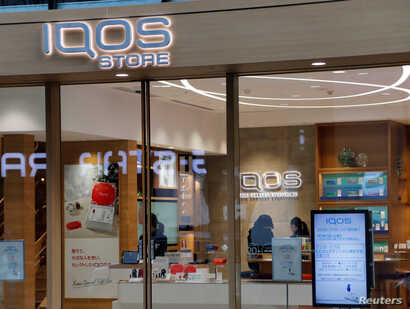 FILE - An iQOS store is pictured at Ginza in Tokyo, Japan, Dec. 18, 2017.