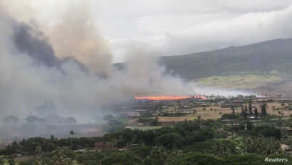 Smoke rises as a wildfire spreads in Kaanapali, Maui, Hawaii, Aug. 24, 2018 in this still image taken from a video obtained from social media.