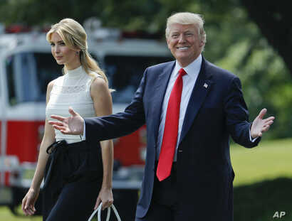 President Donald Trump smiles as he walks with his daughter Ivanka Trump across the South Lawn of the White House in Washington before boarding Marine One helicopter for the trip to nearby Andrews Air Force Base, June 13, 2017.