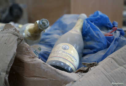 A dusty champagne bottle from an edition commemorating the day former Gambian President Yahya Jammeh came to power is seen in his estate in Kanilai, Gambia, July 1, 2017.