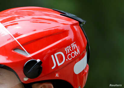 FILE - A logo of JD.com is seen on a helmet of a delivery man in Beijing, China, June 16, 2014.