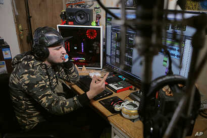 Rapper Ahmed Chayeb records on his computer, Feb. 12, 2019, at his home in the southern port city of Bqasra, Iraq. Chayeb raps about anger and disillusionment in his hometown of Basra, which saw riots last summer over failing services and soaring une...