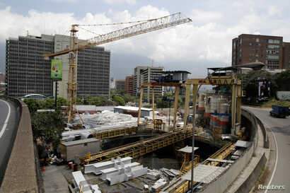 FILE - A view of a construction site by Odebrecht of a metro station is seen in Caracas, Venezuela, March 29, 2017.
