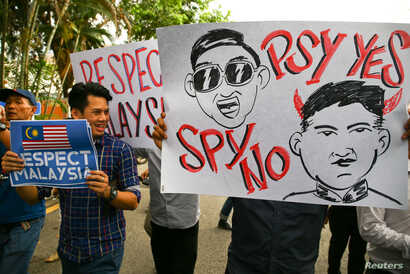 Members of the youth wing of the National Front, Malaysia's ruling coalition, hold placards during a protest at the North Korean Embassy, following the killing of Kim Jong Nam, in Kuala Lumpur, Malaysia, Feb. 23, 2017.