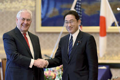 U.S. Secretary of State Rex Tillerson is welcomed by his Japanese counterpart Fumio Kishida at the Iikura Guesthouse in Tokyo,  March 16, 2017. Tillerson said cooperation with allies Japan and South Korea is critical to addressing the threat from Nor...