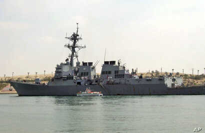 FILE - The U.S. destroyer USS Mason sails in the Suez canal in Ismailia, Egypt, on March 12, 2011. Two missiles fired from rebel-held territory in Yemen landed near the destroyer in the Red Sea.