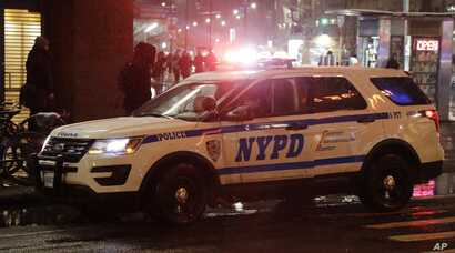 In this Feb. 20, 2019, photo, a police vehicle responds in New York. That long, droning police and ambulance siren that has become part of the soundtrack of New York City for generations could be changing.