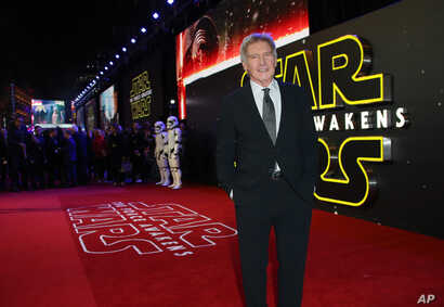 Harrison Ford poses for photographers upon arrival at the European premiere of the film 'Star Wars: The Force Awakens ' in London, Dec. 16, 2015.
