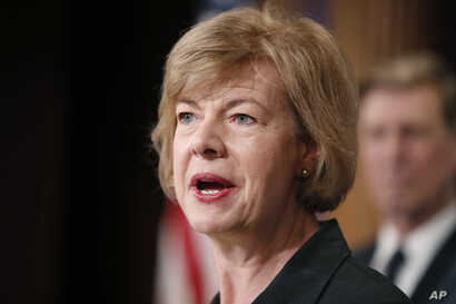 FILE - Sen. Tammy Baldwin, D-Wis., speaks about President Donald Trump's first 100 days, during a media availability on Capitol Hill in Washington, D.C., April 25, 2017.