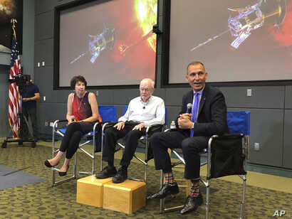 Astrophysicist Eugene Parker sits between Johns Hopkins University project scientist Nicola Fox, left, and NASA's science mission chief Thomas Zurbuchen, during a news conference about the Parker Solar Probe at the Kennedy Space Center in Florida, ...