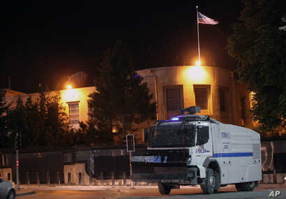 FILE - A police vehicle is seen in front of the U.S. Embassy in Ankara, Turkey, June 22, 2013.