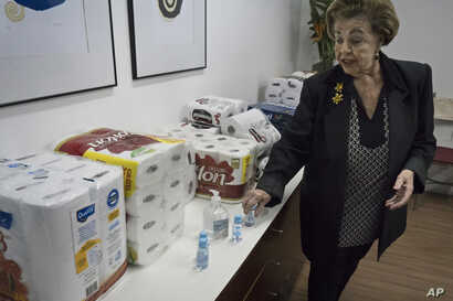 Maria Thereza Sombra, an 81-year-old former teacher who heads the neighborhood association in Rio's tony Morro da Viuva area, shows items donated by residents to the local police station in Rio de Janeiro, Brazil, June 17, 2016.
