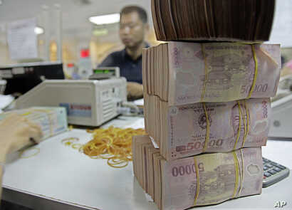 Vietnamese  money Dong is seen in Asia Commercial Bank in Hanoi,Vietnam.
