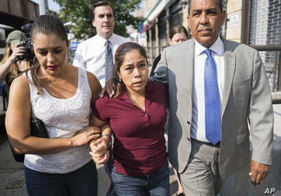 Yeni Gonzalez, center, a Guatemalan mother who was separated from her three children at the U.S.-Mexico border arrives, July 3, 2108 to reunite with them in New York.  A team of volunteers drove Gonzalez from Arizona after she was released from Eloy ...