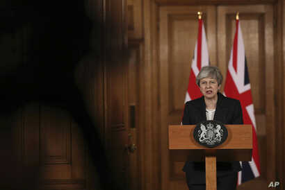 """Britain's Prime Minister Theresa May delivers a statement, at 10 Downing Street, in London, March 20, 2019. May says it's a matter of """"great personal regret"""" that U.K. won't leave the EU with a deal on March 29."""