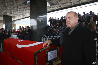 Turkey's President Recep Tayyip Erdogan speaks during the funeral prayers for Sergeant Musa Ozalkan, the first Turkish soldier to be killed in Turkey's cross-border Operation Olive Branch in northern Syria, in Ankara, Turkey, Jan. 23, 2018.