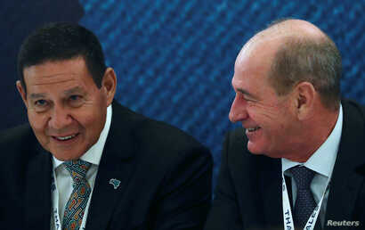 Brazil's Vice President Hamilton Mourao, left,  and Brazil's Defense Minister Fernando Azevedo e Silva attend a conference during LAAD, the biggest military industry expo in Latin America, in Rio de Janeiro, April 2, 2019.