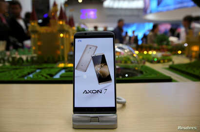 A ZTE Axon7 device is displayed at company's booth during Mobile World Congress in Barcelona, Spain, Feb. 27, 2017.