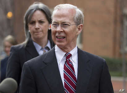 FILE -  Dana Boente, then-first assistant U.S. attorney for the Eastern District of Virginia, leaves federal court in Alexandria, Va., Jan. 26, 2012. Boente was appointed to serve as acting attorney general after his predecessor refused to defend Pre...