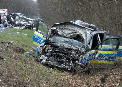 A damaged police car is seen next to a road in Langen near Frankfurt, Germany, Sunday, March 31, 2019.