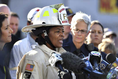 Oakland Fire Chief Teresa Deloach-Reed speaks to members of the media after a deadly fire tore through a warehouse during a late-night electronic music party in Oakland, Calif., Dec. 3, 2016.
