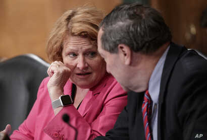 Sen. Heidi Heitkamp, D-N.D., (L) and Sen. Joe Donnelly, D-Ind., listen as the Senate Banking Committee holds a hearing on U.S. economic sanctions against Russia and whether the actions are effective, on Capitol Hill in Washington, Aug. 21, 2018.
